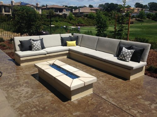 an image of some custom concrete at an outdoor sitting area with benches and a firepit