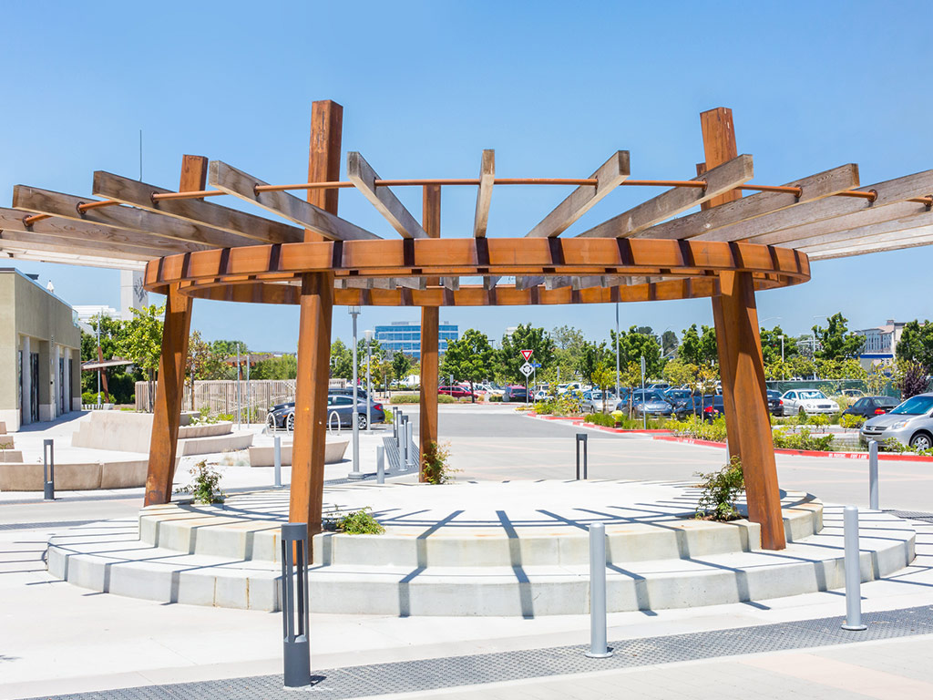 an image of a circular pergola outdoors in a public sitting area